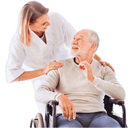 caregiver and elderly man looking at each other smiling