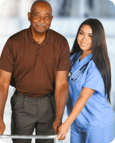 caregiver assisting elderly man
