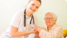 nurse holding the hands of old woman