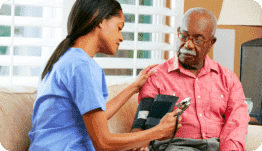 caregiver checking blood pressure