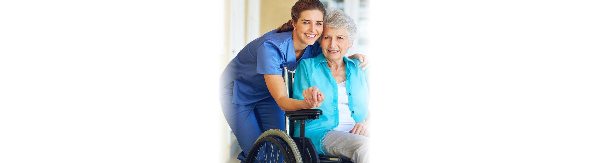caregiver and elderwoman smiling