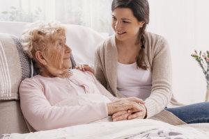 woman assisting senior woman