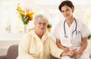 caregiver and old woman smiling